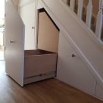 White banisters with under stair storage space half hidden