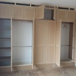 Bespoke wardrobe progress view, with doors open.