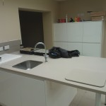 Bespoke kitchen installation, white cabinets and island