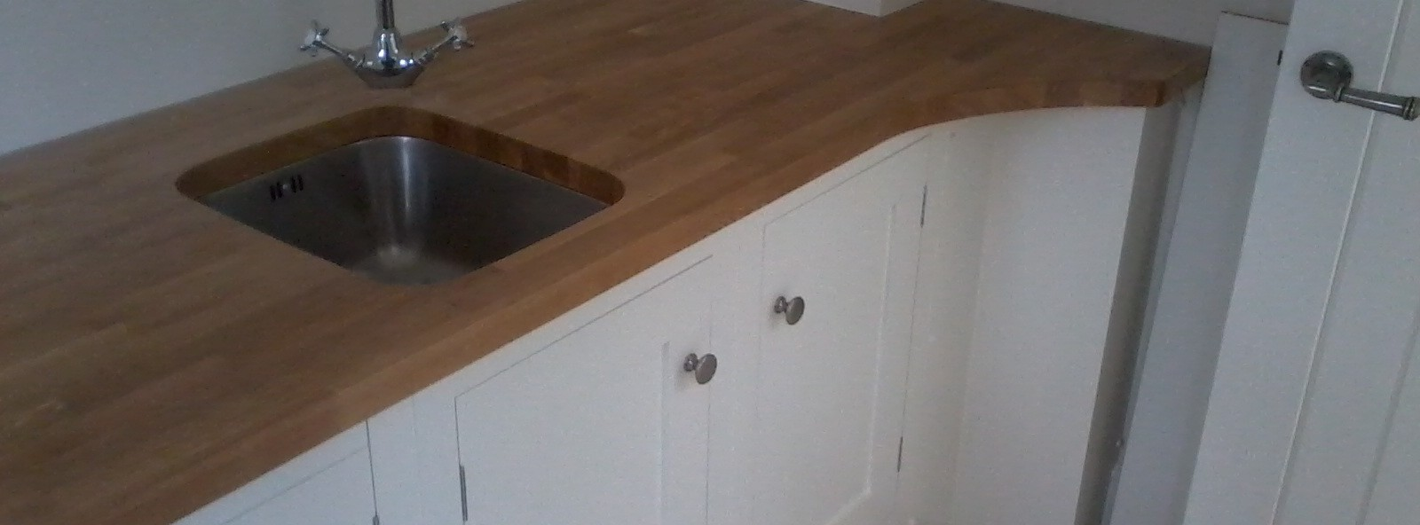 Bespoke kitchen sink installation.
