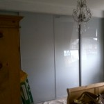 Bespoke sliding door wardrobe installed, closed door.
